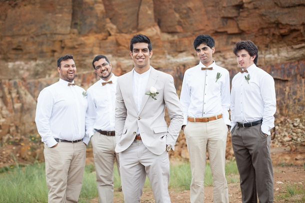 Groomsmen in Neutral Suits and Tweed Bow Ties