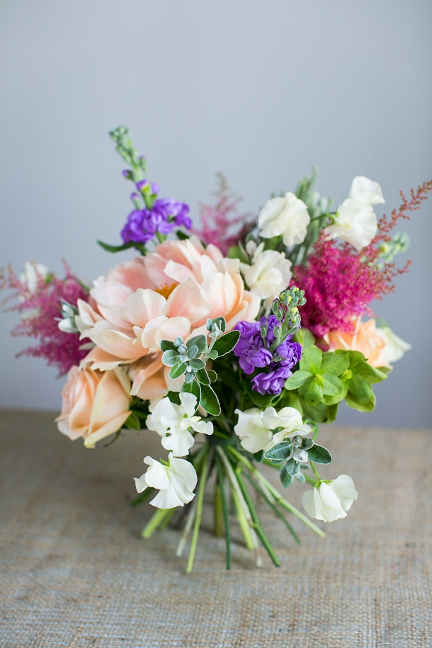 Spring bouquet with peonies, avalanche rose, stock, astilbe, sweet pea, brunia, hellebore,  senecio