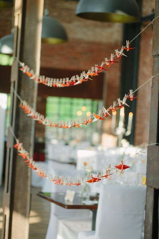 white & orange origami crane escort cards