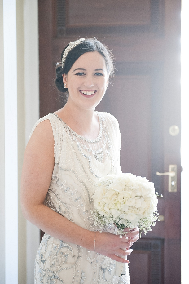 Bride in Jenny Packham with rose & baby's breath bouquet by Wild About