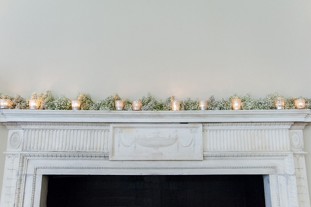 Flowers & candles fireplace display