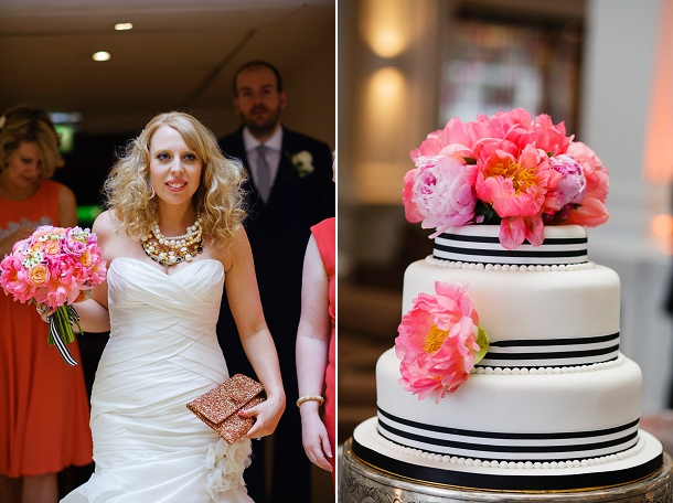 Coral wedding cake with black & white ribbons