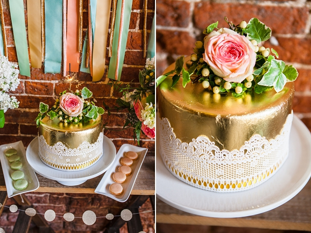 gold lace wedding cake with floral topper