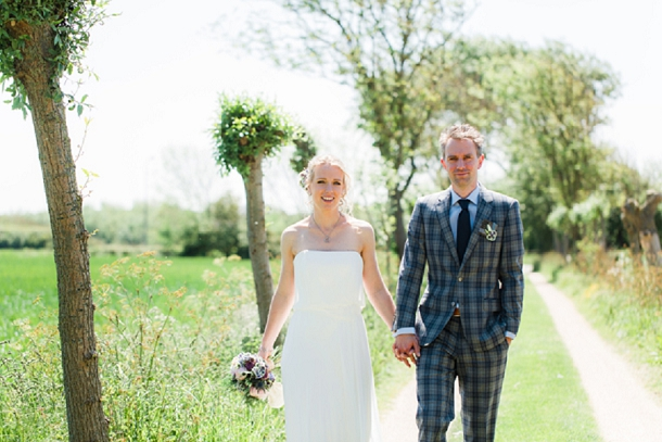 Rustic wedding with a tartan suit