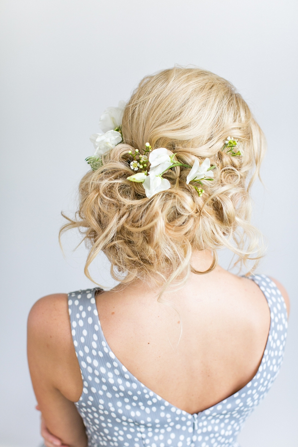 Loose bridal up do with floral crown