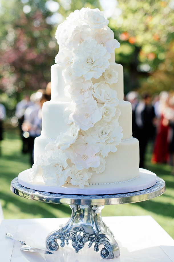 White wedding cake with flowers by Cakes by Wade