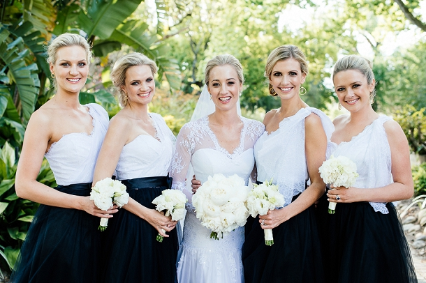 monochrome bridesmiads dresses with white bouquets