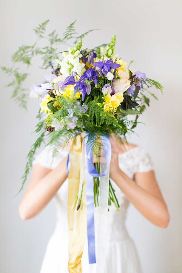 Freesia, sweet pea, rose, scabious & asparagus fern cascading yellow & lavender mediterranean bouquet  & Louise Beukes Styling