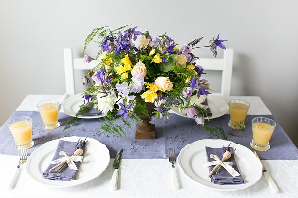 Lavender & honey wedding table setting with bee motif