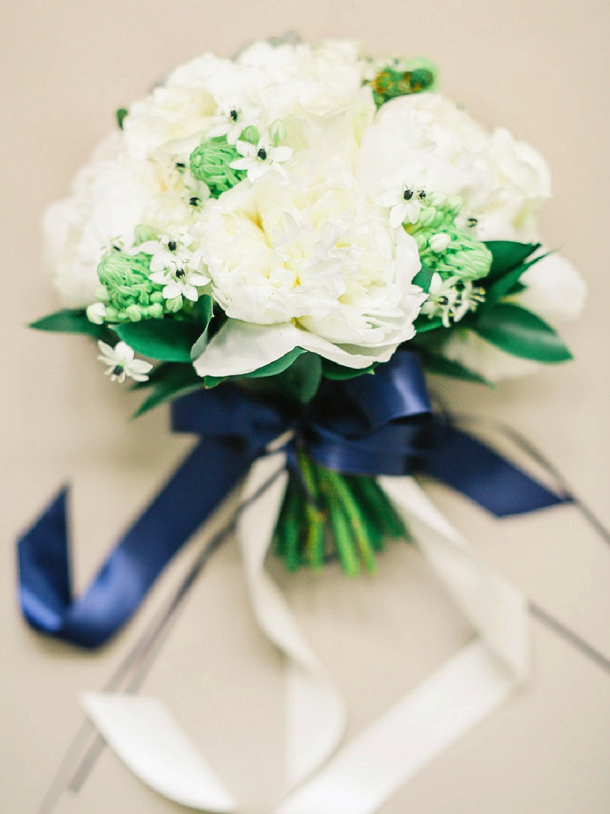 White peony bouquet with navy ribbons by Blue Sky Flowers
