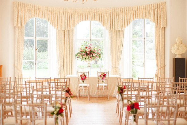 berry coloured wedding pew ends at kew garden wedding ceremony