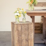 Welcome drinks station with crates and wooden table