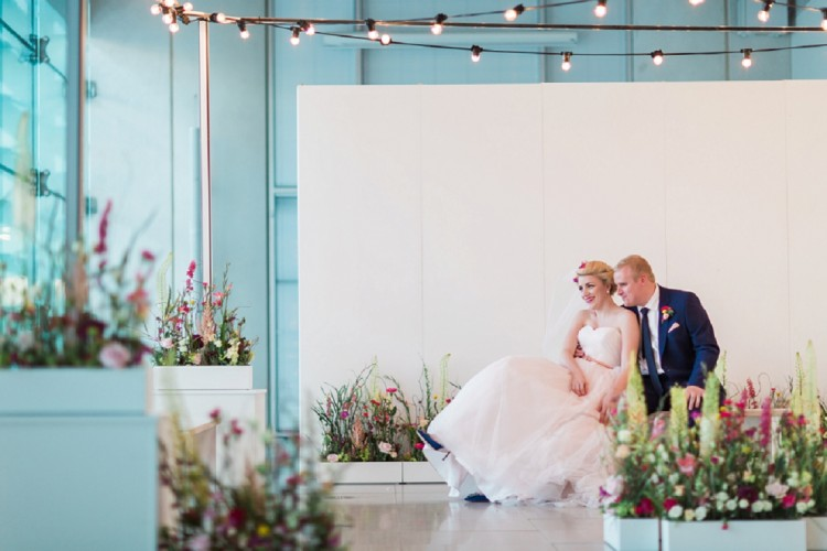 modern industrial wedding decor with wildflowers