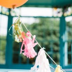 brightly coloured wedding balloons and tassels