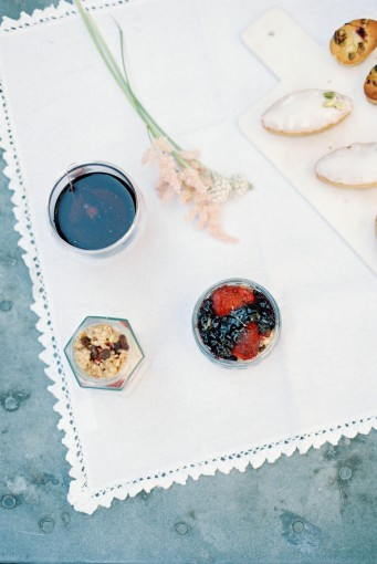 Berry and granola breakfast food on white lace linen