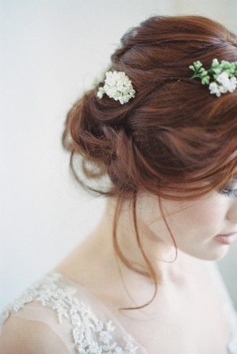 Romantic bridal updo with flowers