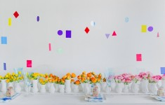 Colourful wedding tablescape styled by Inspire Hire with geometric hanging table installation