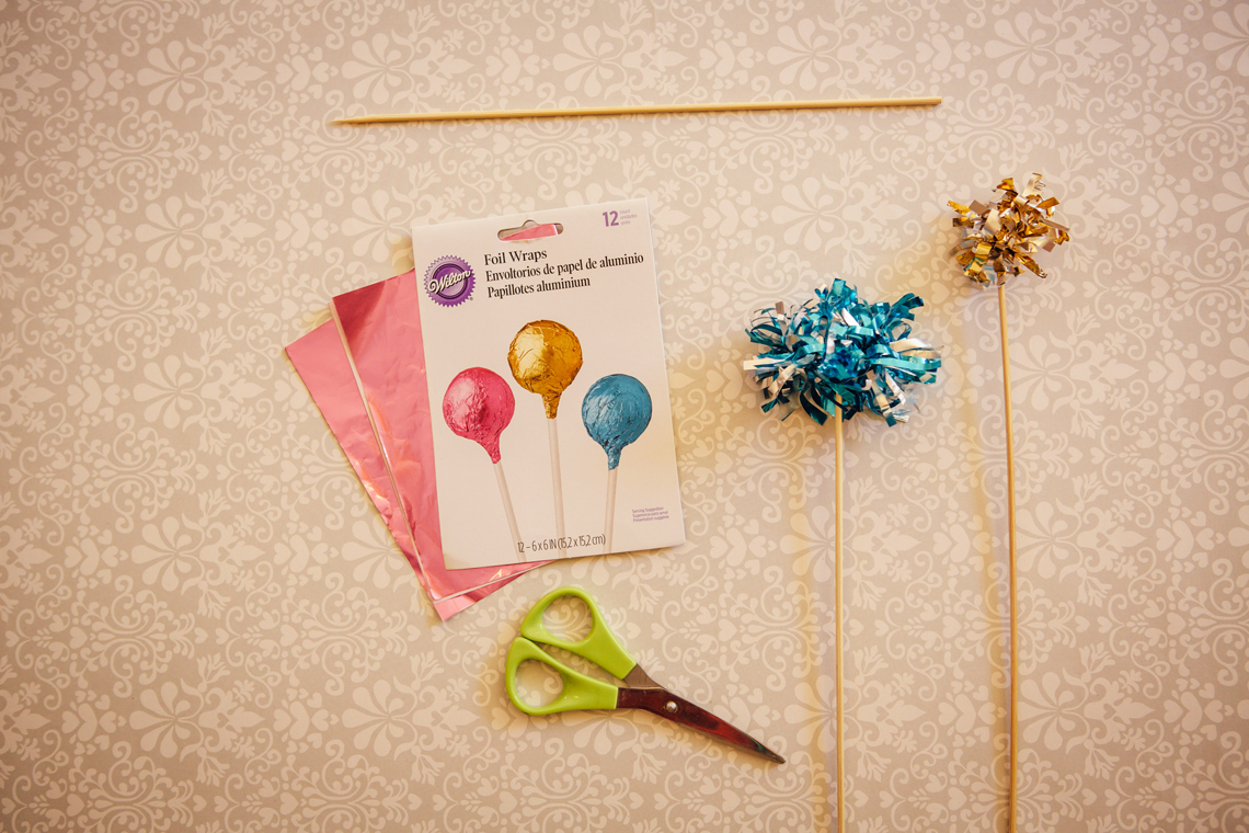 2 DIY tutorial Festive Firework Pom Pom Cake Topper Wedding Party New Years Eve by Hip Hip Hooray for b.loved blog