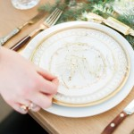 Mismatched gold plates place setting