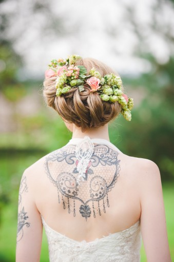 Tattoo'd bride with floral hair crown