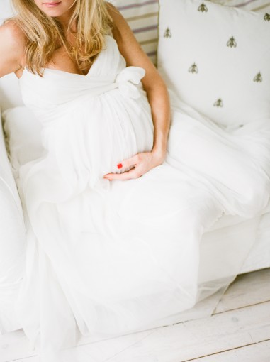 White maternity shoot on film with white dress and barefoot