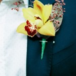 yellow orchid buttonhole by tilly tomlinson flowers