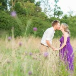 couple purple maternity session in a field