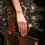gold rings & clutch bag