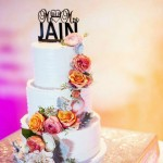 white-wedding-cake-with-colourful-flowers
