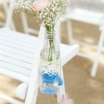chair-deocr-with-flowers-in-vintage-bottles