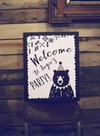 black & white first birthday party welcome sign