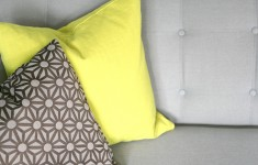 Chartreuse cushion on grey sofa