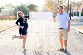 sunset maternity shoot in south africa with navy dress and gold details