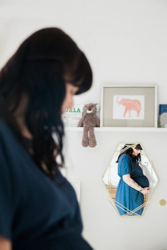 Chic maternity session nursery mirror reflection