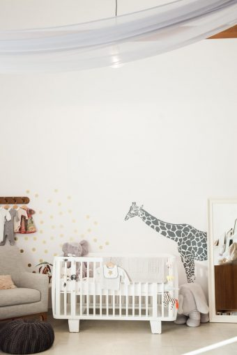 white retro crib nursery decor with large giraffe wall sticker