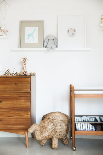 shelf styling for nursery inspirations with prints and soft toys