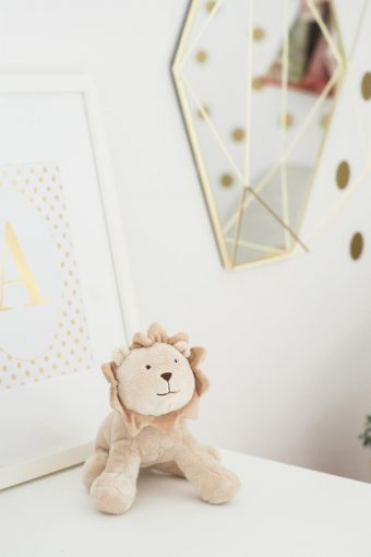 nursery decor with lion soft toy gold dots wall sticker and framed initial print