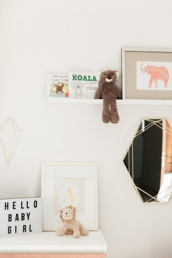 nursery decor ideas with shelf styling books soft toy and framed prints