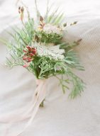 pretty foraged floral bouquet displayed on a blanket