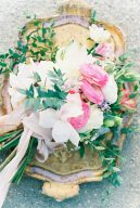 stunning bouquet of florals tied with ribbon and sat upon a gold tray