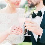 Bride and groom toasting a drink together