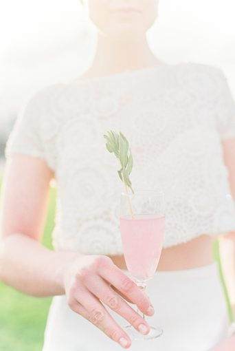 Bride drinking pink champagne