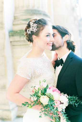 Groom kisses the Bride tenderly on the cheek