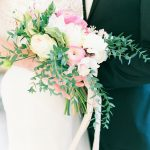 bride and groom holding beautiful bouquet