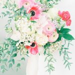 beautiful bouquet with pink and red flowers and green foliage