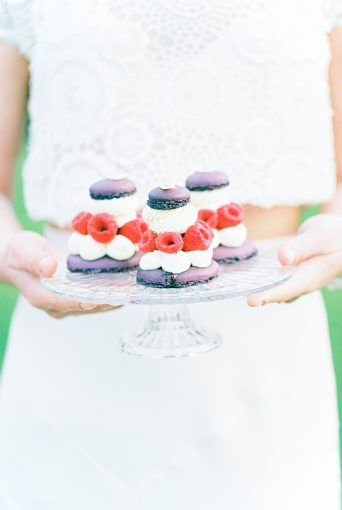 pretty cake stand display with delicious desserts with berries