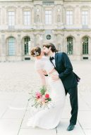 bride and groom kiss in Paris