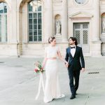 Bride and Groom holding hands through the streets of Paris