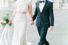stylish bride and groom couple strolling along the streets of romantic Paris