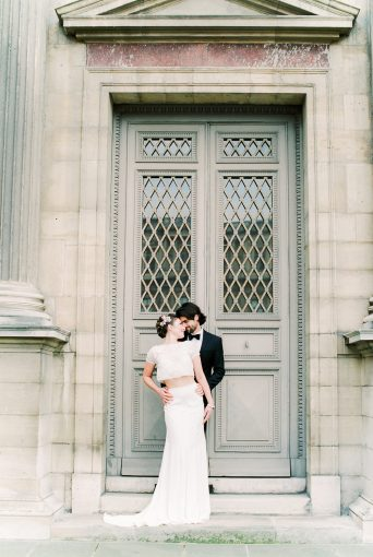parisian elopement couple in front of beautiful architecture